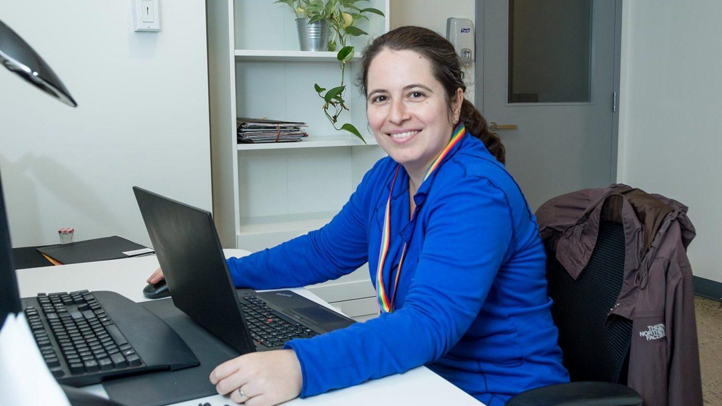 team member sitting at desk